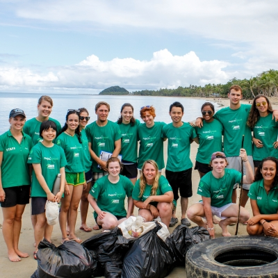 A group of Projects Abroad volunteers assist with a beach clean-up initiative where no experience is needed to volunteer overseas.